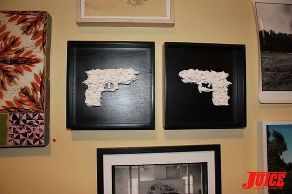 GUNS MADE OF WHITE PLASTIC ARMY MEN. PHOTO: VANESSA DAVEY