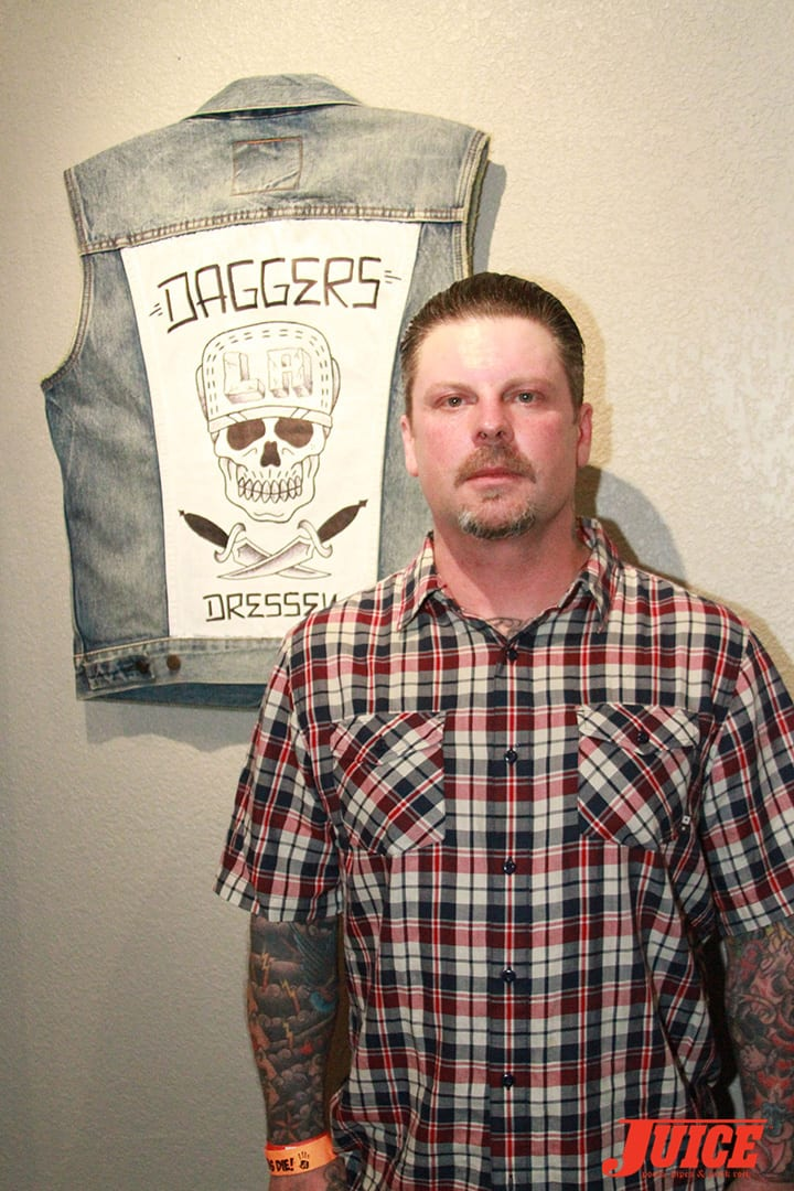 Eric Dressen with his vest creation. Daggers Rule! 2014. Photo by Dan Levy