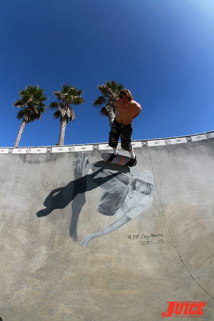 Seven Adams surf/skate carving over the mural of Jay Adams