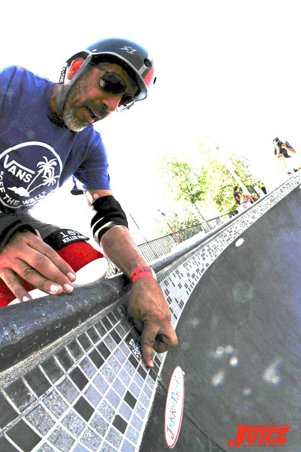 Elguera puts Jay Boy sticker on the tiles - Skate For A Cause 2015. Photo by Dan Levy