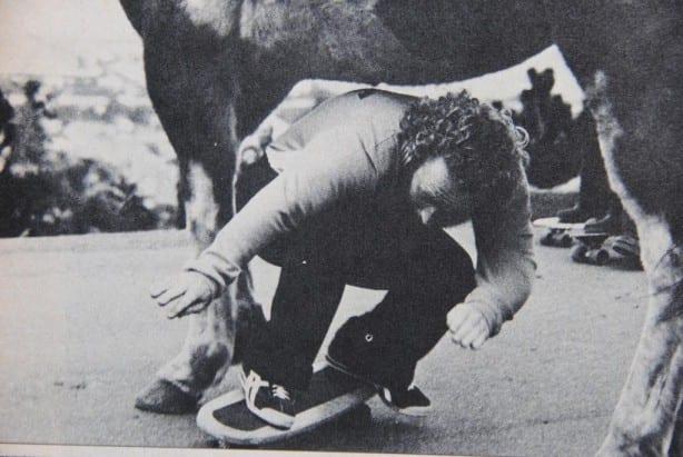 Dale Smith skates under a donkey