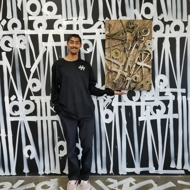 Vincent Luevanos with Retna artwork. Photo by Heidi Lemmon