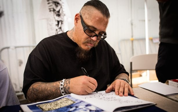 Ric Clayton signs his new book @beyondthestreetsart Photo by VenicePaparazzi.com