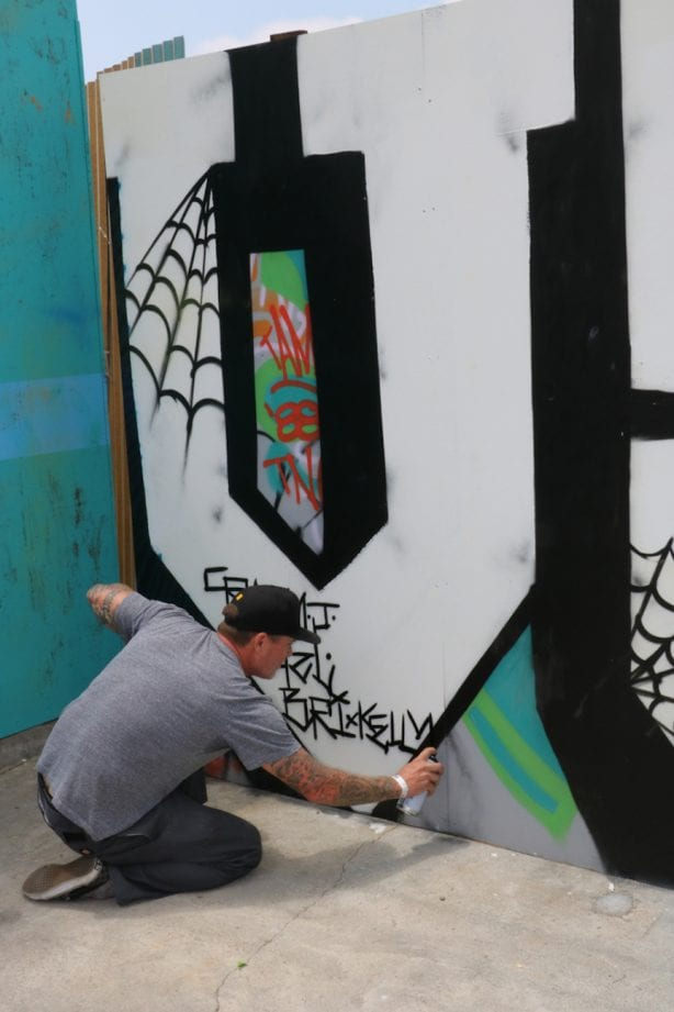 Crazy J tags the wall. Photo by Kelly Jackson